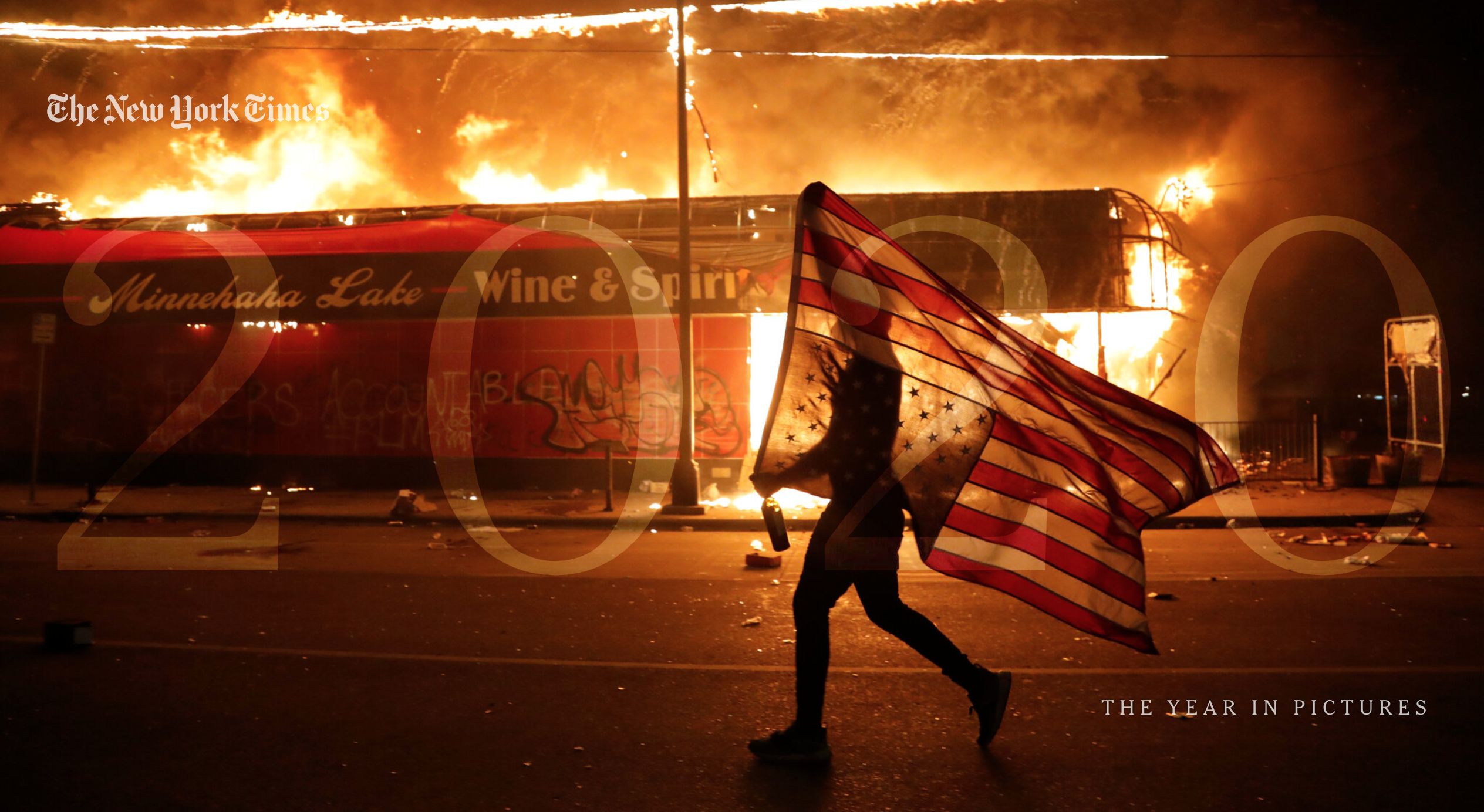 Screenshot of the New York Times 2020 Year in Pictures, showing a person holding an upside-down American flag against the backdrop of a burning building.